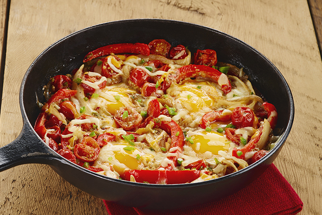 Poêlée d'œufs et de tomates épicée Image 1