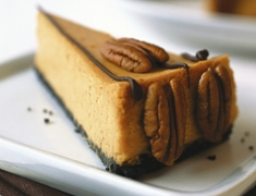 Festive Pumpkin Cheesecake with Chocolate Crust
