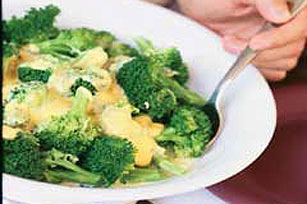 Broccoli with Cheesy VELVEETA Sauce