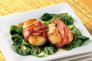 Turkey Bacon-Wrapped Scallops with Wilted Spinach Image 1
