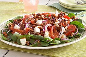 Ensalada caliente de espinacas con tomates