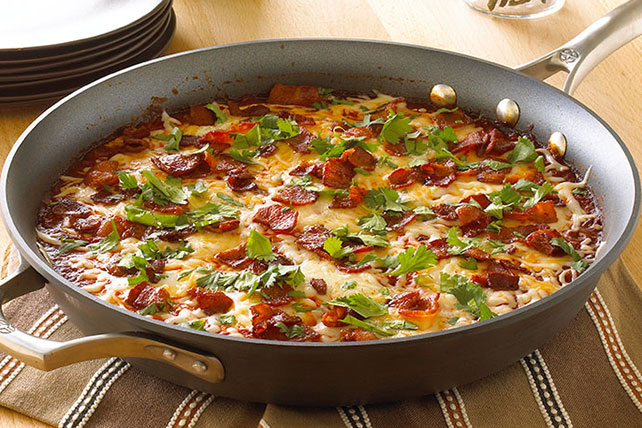 Eggs Poached in Ancho-Tomato Sauce Image 1