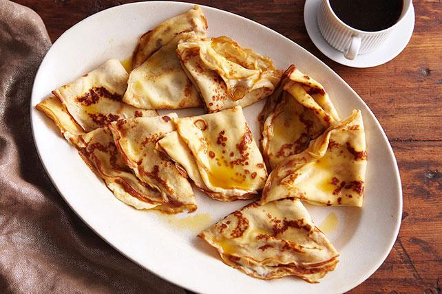 Creamy Filled Crêpes Suzette Image 1