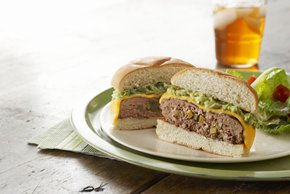 Jalapeño-Stuffed Cheeseburgers with Guacamole Topping