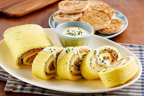 Eggs Benedict Omelet Roll with Hollandaise