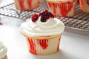 White Chocolate-Cranberry Poke Cupcakes