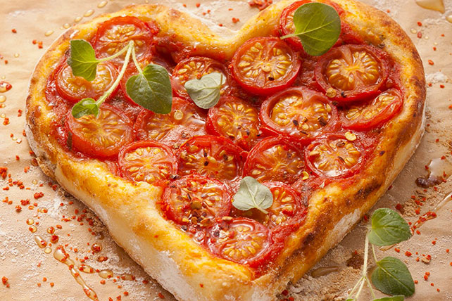Heart-Shaped Cheese and Tomato Pizza Image 1