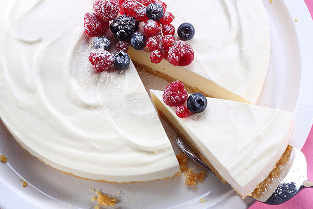 Cheesecake with Berries and Whipped Topping Image 1