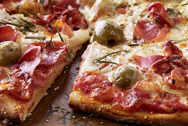 Pizza with Prosciutto, Green Olives and Rosemary Image 1