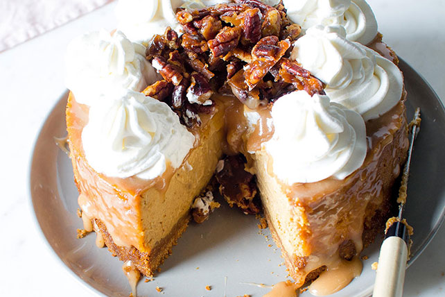 Pumpkin Spice Cheesecake with Salted Caramel, Candied Pecans and Whipped Cream Image 1