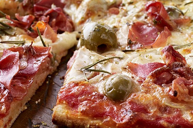 Pizza with Smoked Ham, Green Olives and Rosemary Image 1