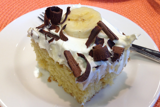Pudding Poke Cake with Bananas and Chocolate Curls Image 1