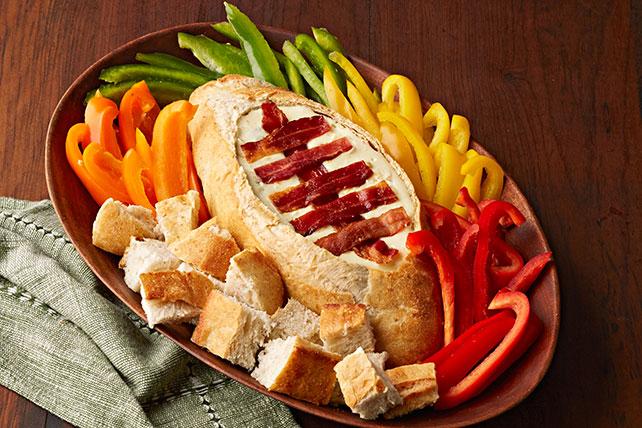 Dip de queso en tazón hecho de pan en forma de pelota de fútbol  Image 1