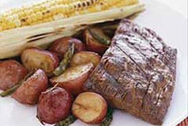 Barbecued Flank Steak with Roasted Vegetables and Corn Image 1