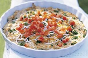 Trempette de fromage et de pois chiches avec garniture aux tomates